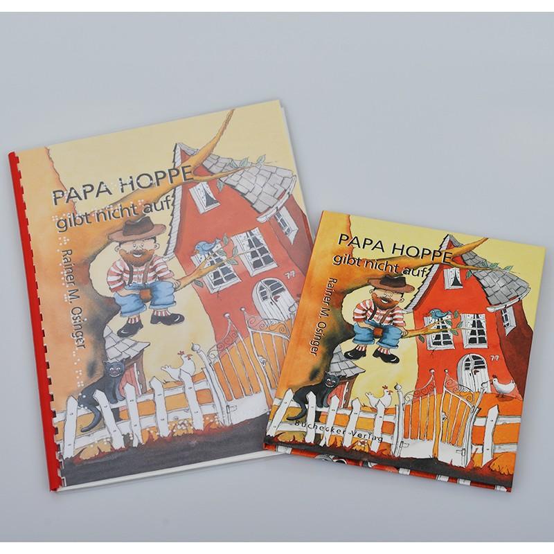Ein Bild von dem Braillebuch + Bilderbuch Papa Hoppe gibt nicht auf.